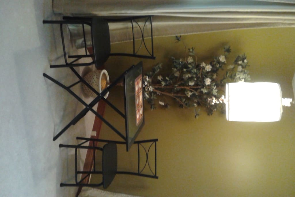 Bistro table located in Garden Room.