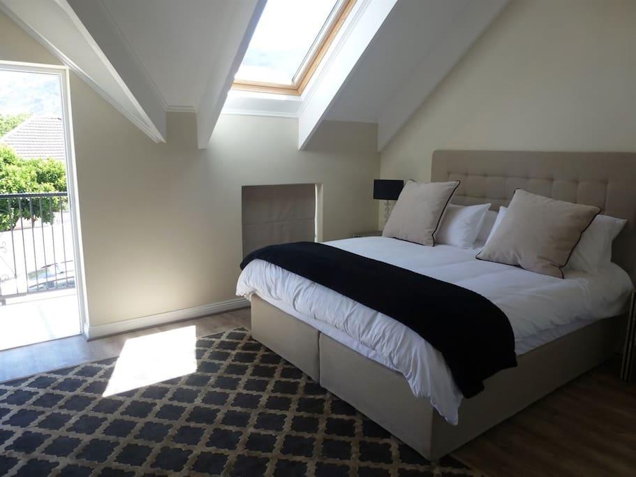 lxury bedroom opens onto patio