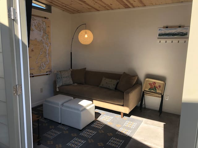 "Living room w/TV and ""Alexa"" plus kitchen"