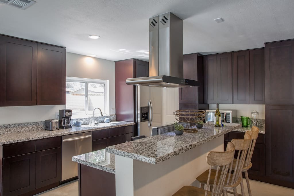 Open Concept Floor Plan with Kitchen and Living Room area adjacent to Dining Room.