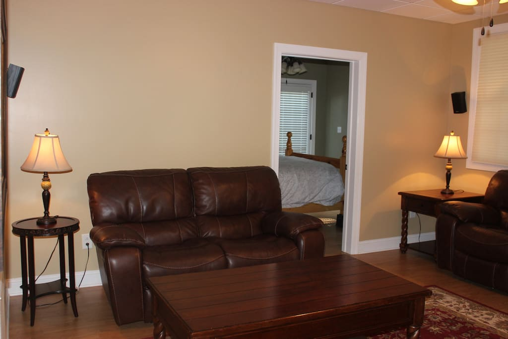 Family room with two leather reclining couches.