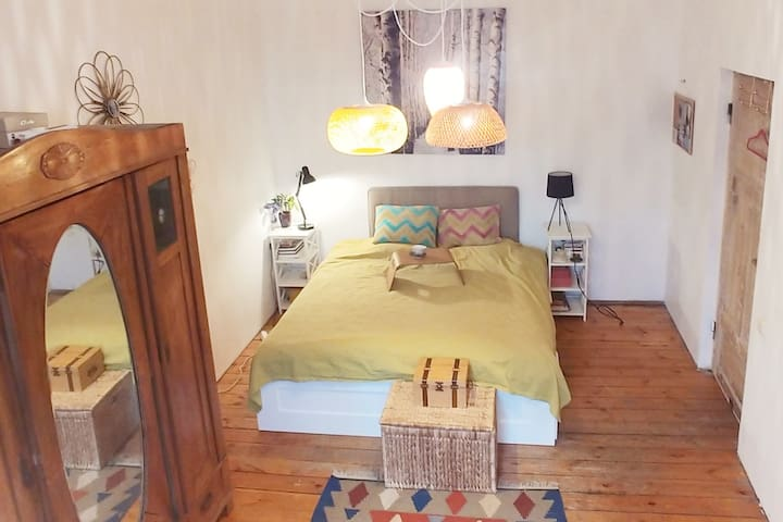 Boho bedroom with extra space in hipster part Riga