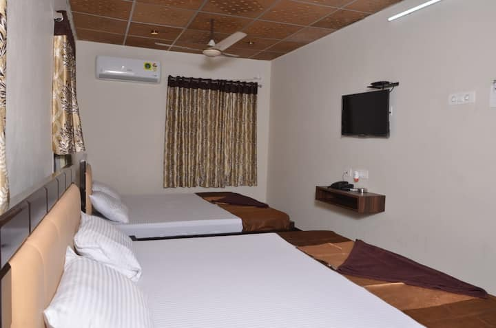 Dwaraka Residency Quad Occupancy Room