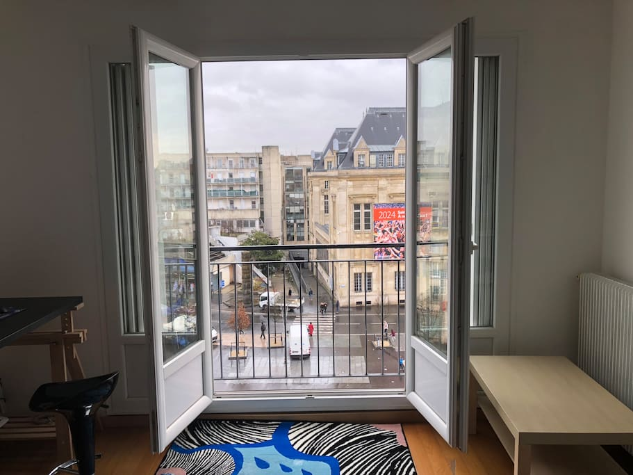 Double doors open onto a small terrace