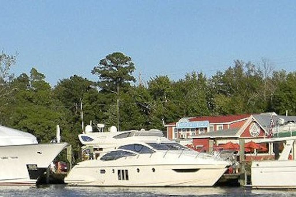 Enjoy watching the large vessels of the Intercoastal Waterway dock at the Coinjock Marina over a delicious meal at the Coinjock Marina Restaurant!C