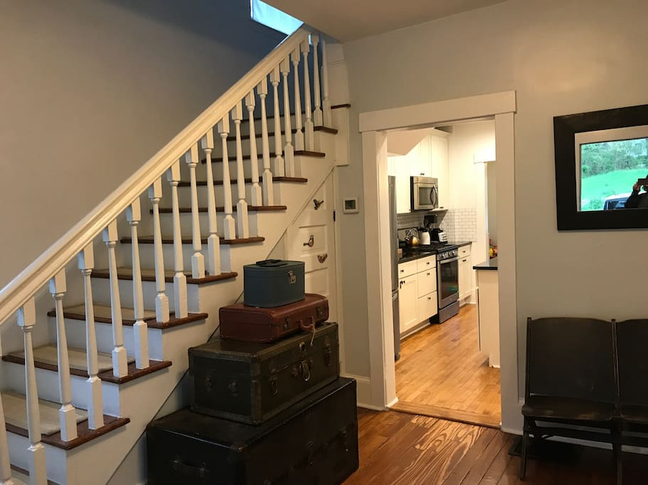 Entryway with stairs to bedrooms and full baths