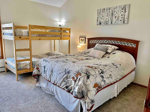 2nd bedroom with full bed and bunk beds