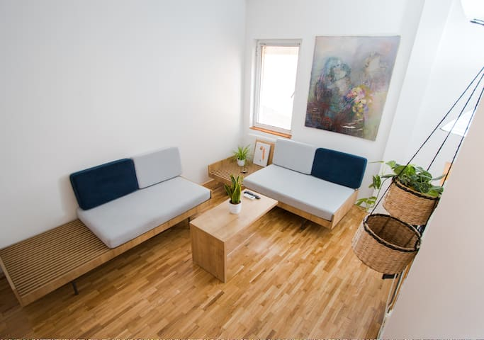 The living room is equipped with TV and air-conditioning. It has 2 sofas adaptable in 2 single beds.