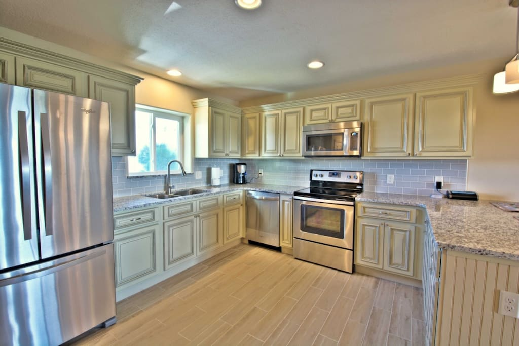 Kitchen is well appointed with granite countertops and stainless applainces