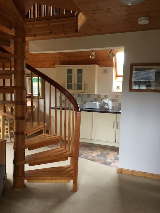 Entrance and spiral staircase to the upstairs bedroom