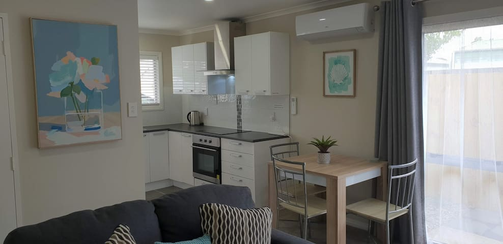 Kitchen and Dining Area. Also showing Air Conditioning unit.