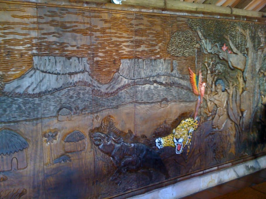 A wall out of wood carving in our social area, where we also serve breakfast.