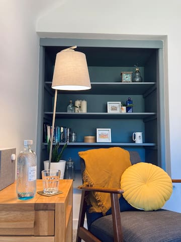 A cosy reading nook with beautiful views of the walled garden. Or use our sound system and enjoy a relaxing drink whilst listening to your favourite tune.