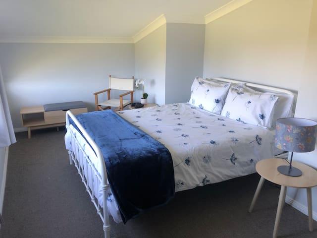 Queen bed in main bedroom upstairs