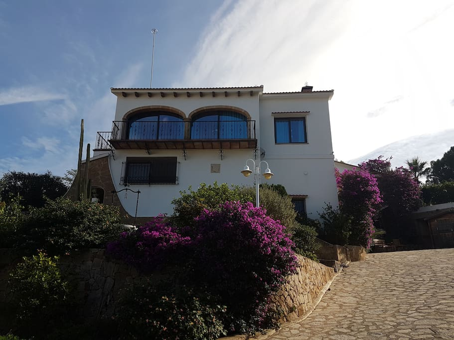 View of the villa from the Western Lower garden. All large windows and balconies are North- and West-orientated.