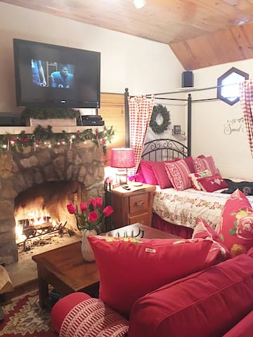 Snuggle up with hot cocoa. This fireplace heats the whole place like a charm but there is also a wall heater.