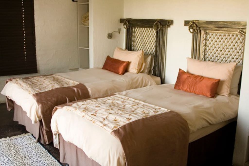 2 guest rooms with 2 single beds in each.