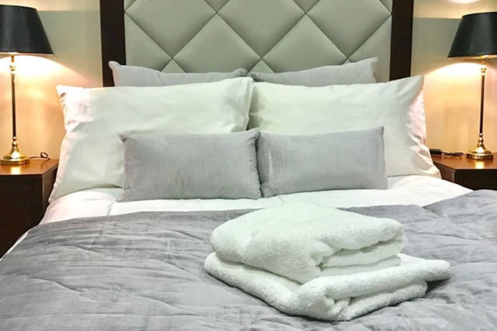 Double bedroom with luxury furnishings linens.