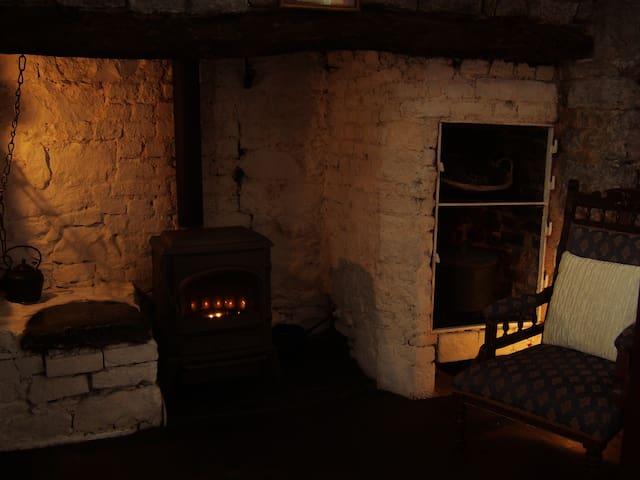 Original  Stone and Twisted Oak  fireplace