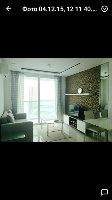 Sitting room with 2 seated sofa bed, DVD, TV & clock
