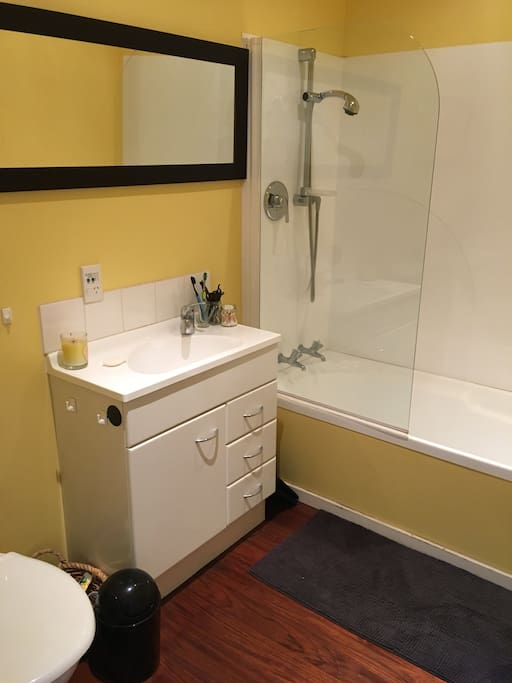 Private bathroom with shower and bath, off main bedroom