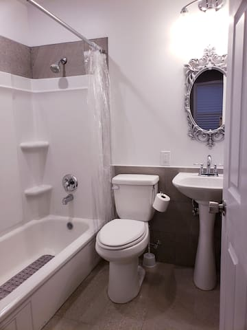 Fully renovated attached bathroom has ceramic tile