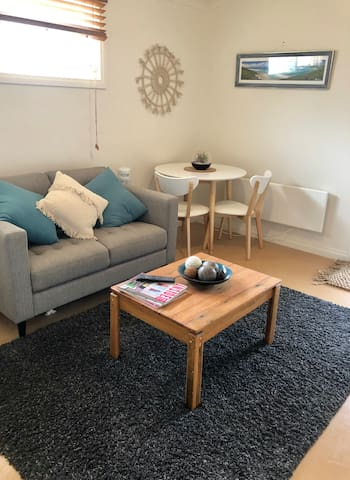 Cosy, light sitting room, with television, wifi, heating and cooling. Perfect place to unwind.