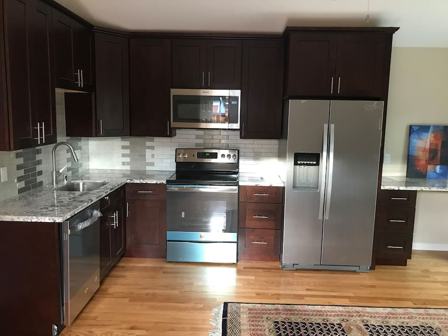 Kitchen with full stove, fridge, dishwasher