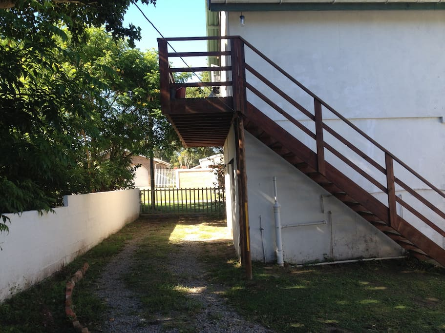 Stairs lead up to the apartment and private entry gate