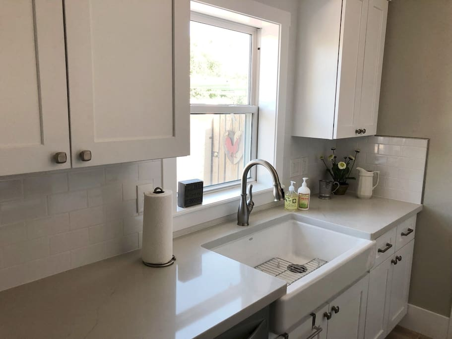 Everything is brand new in this beautiful farm house suite, right down to the farmhouse sink.