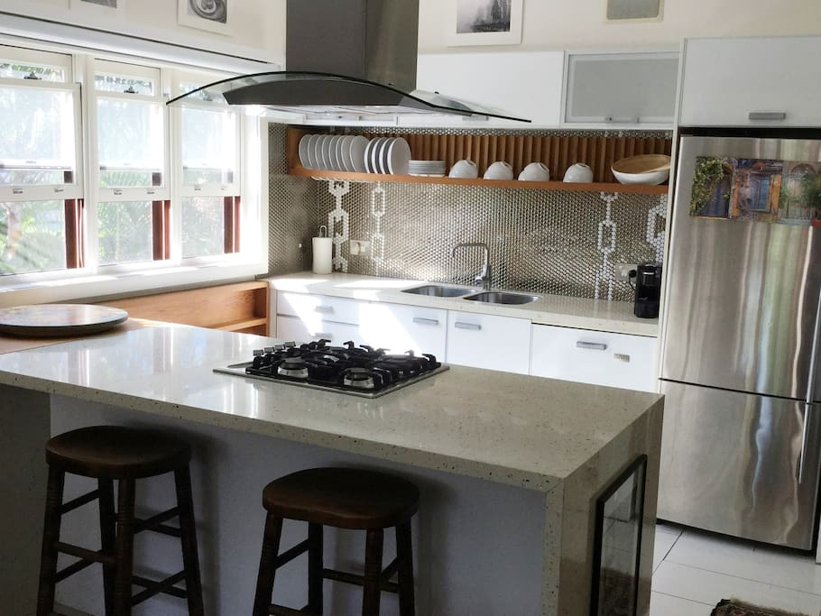 Modern kitchen with gas stove, oven, dishwasher and small appliance.