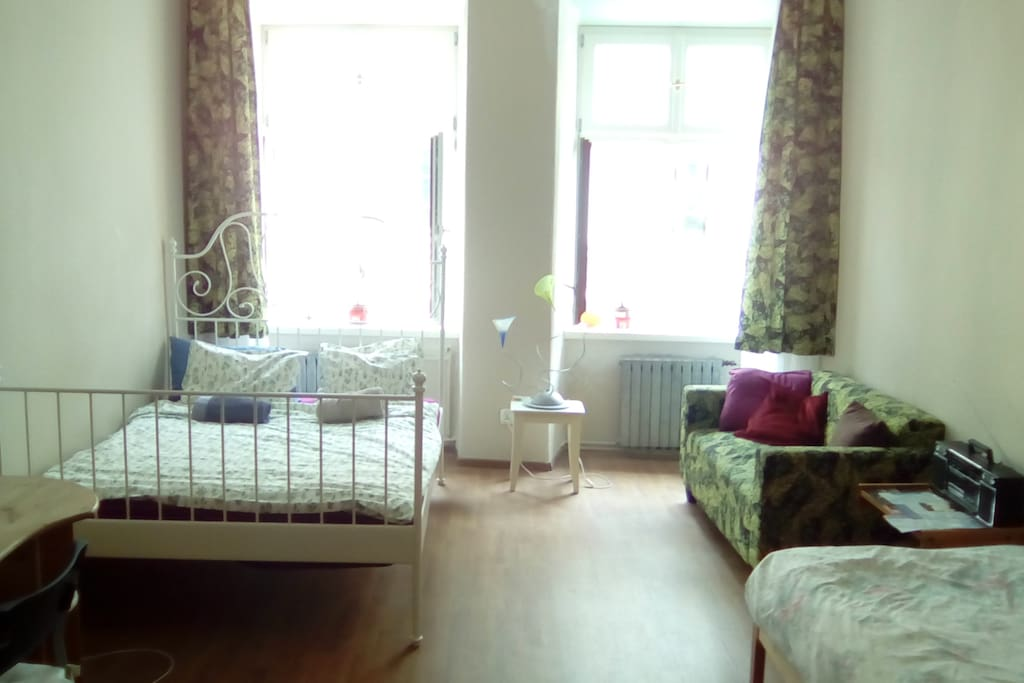 The bedroom is large and contains a real double bed, single bed and couch