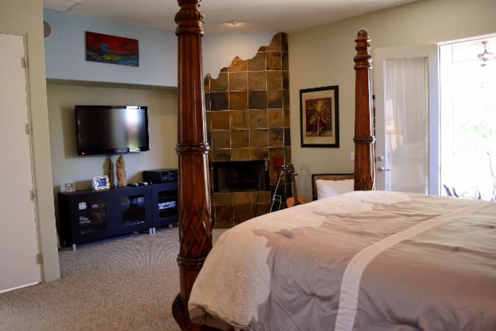 Master Bedroom features, King size bed, fireplace and French doors to patio