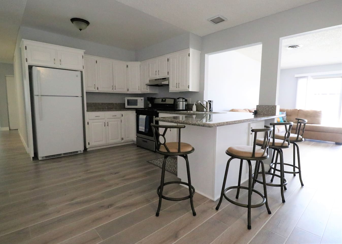 Shared kitchen space, with coffee maker, pressure cooker, microwave, stove, fridge, etc.