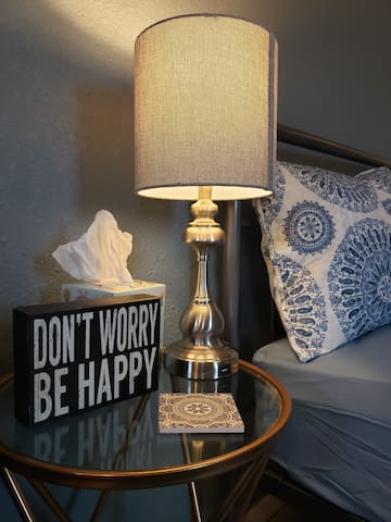 Bedside lamps have USB charge ports for convenience.