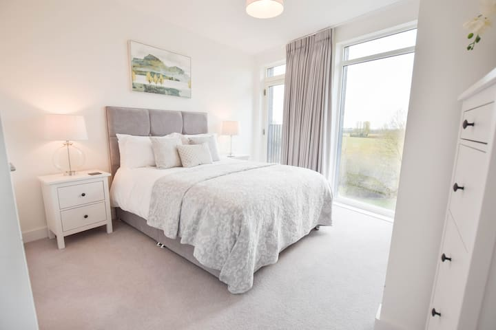 Beautiful king bed in the master bedroom with ensuite