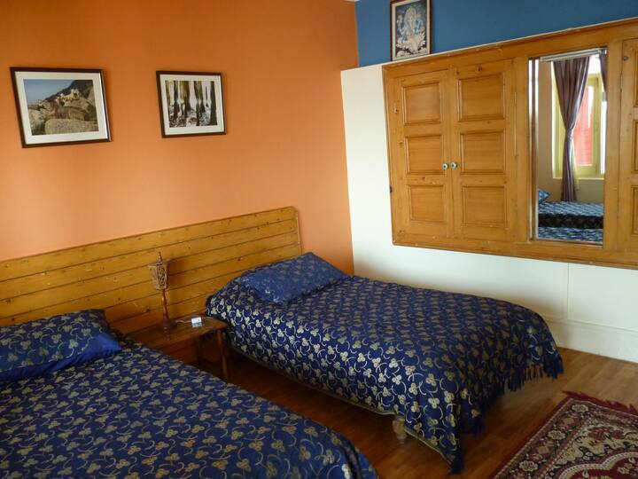 Twin village room above Dharamshala, shared bath
