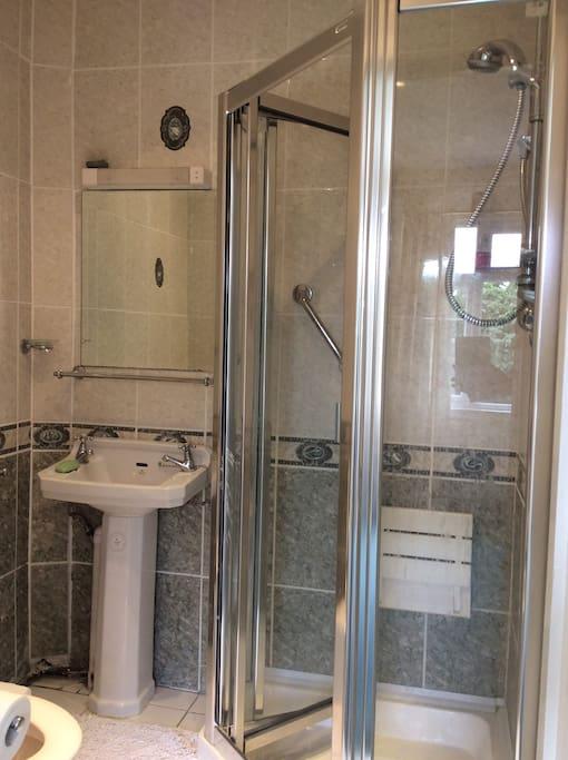 Bathroom with Shower, Wash Hand Basin & Toilet.