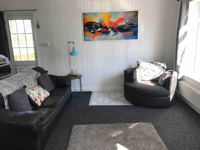 Fabulous bright  living room, perfect for relaxing in, smart tv with in built DVD player, lots of great dvd movies in press under tv. USB charging points for your use in living room