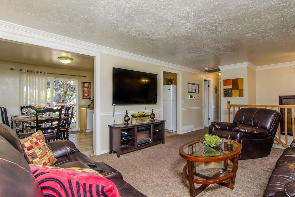 Family room  with sectional sofa and 55 inch TV