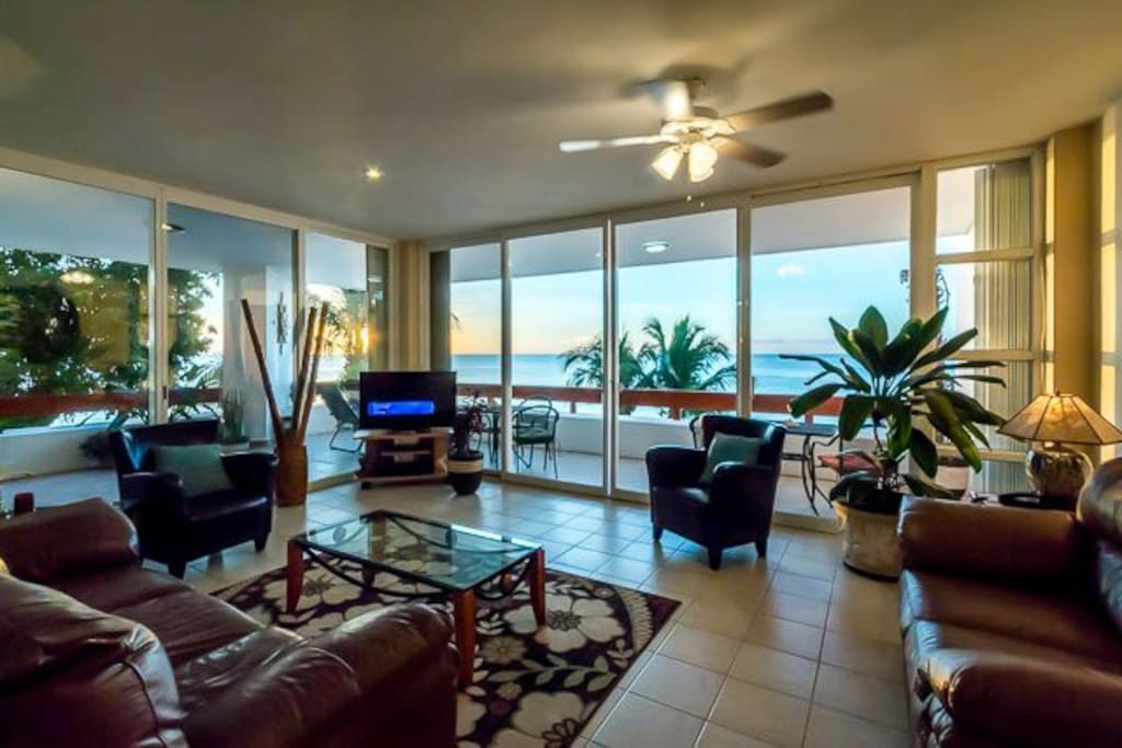 Living room with wrap-around deck and Dish Network TV programming