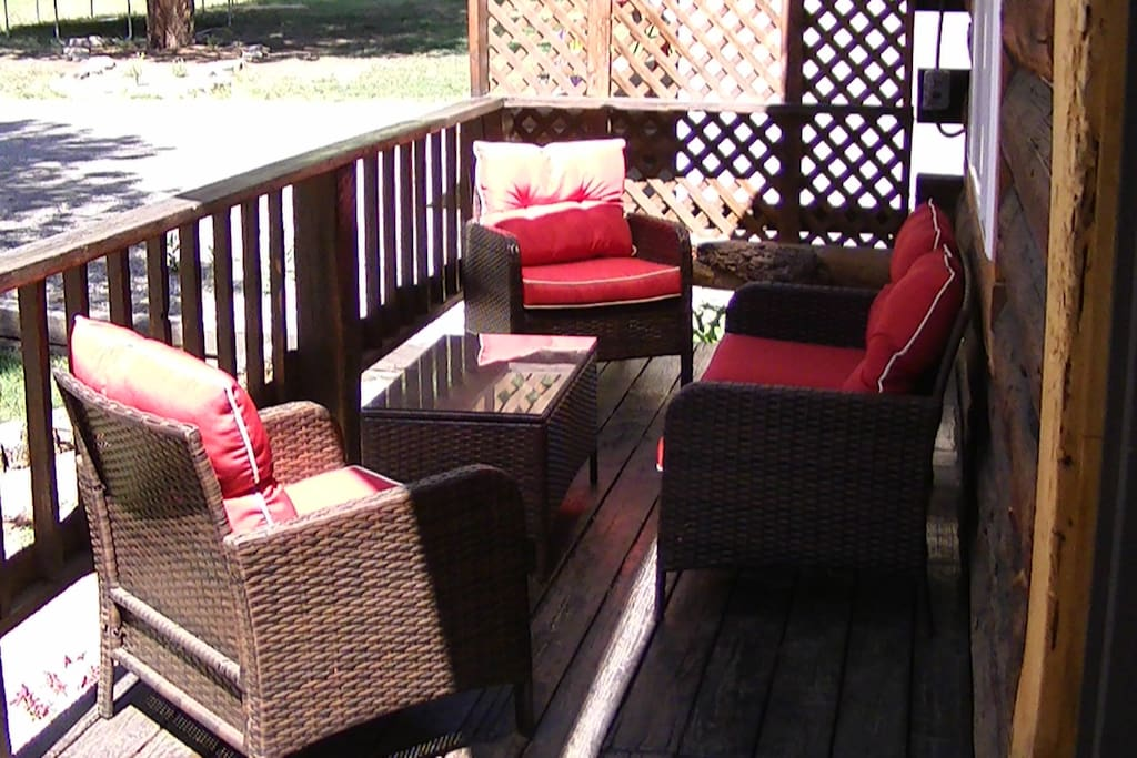 Comfortable deck seating under shade sails.