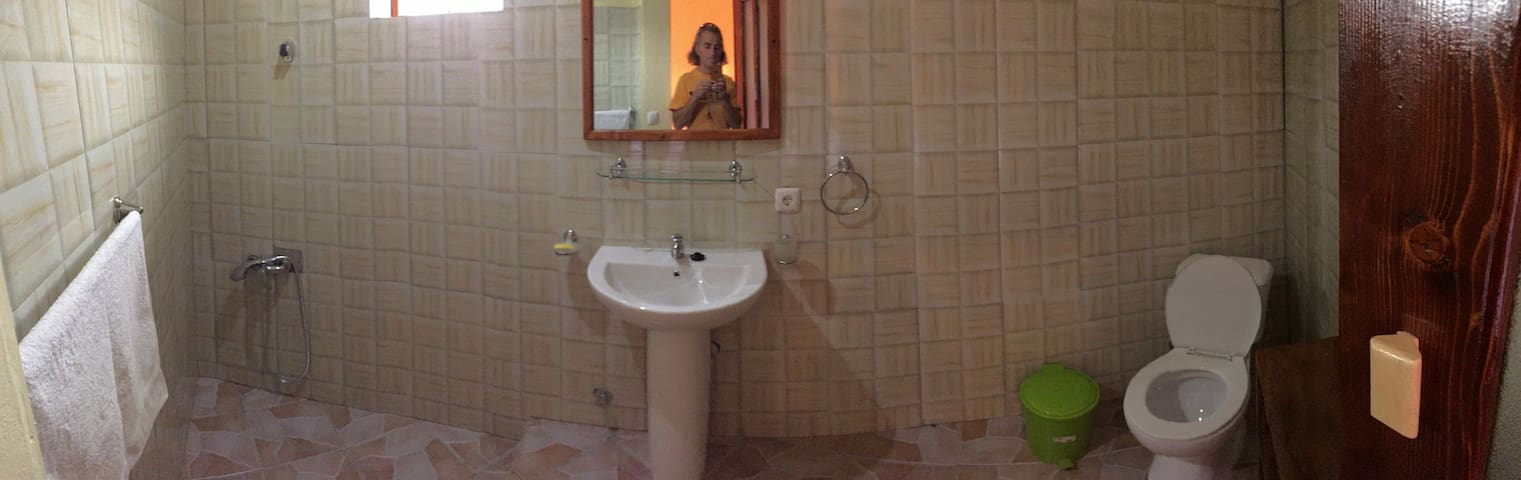 Bathroom of the Funku. PS.: Person in the mirror can change !