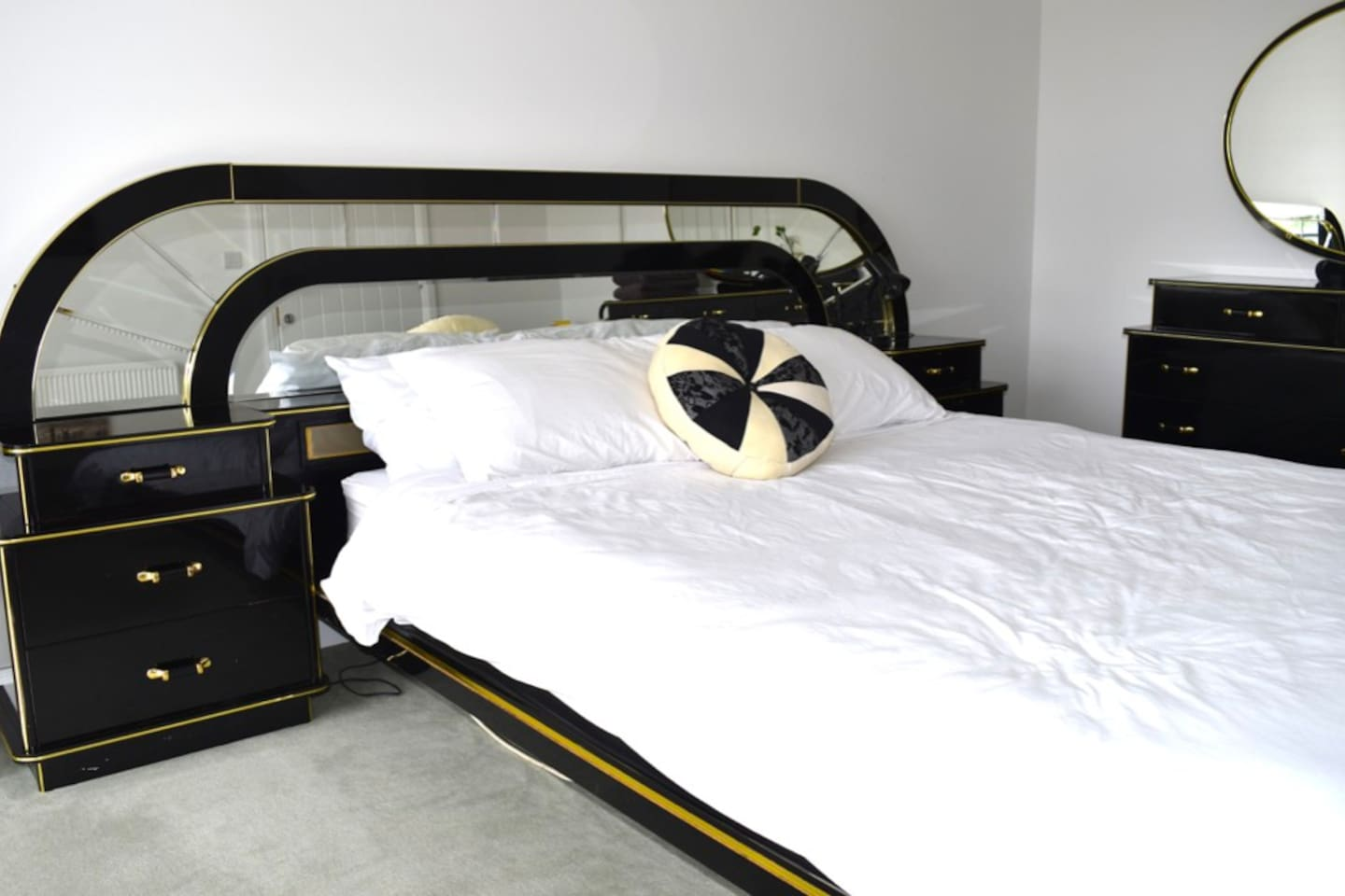Spacious art deco double bed.