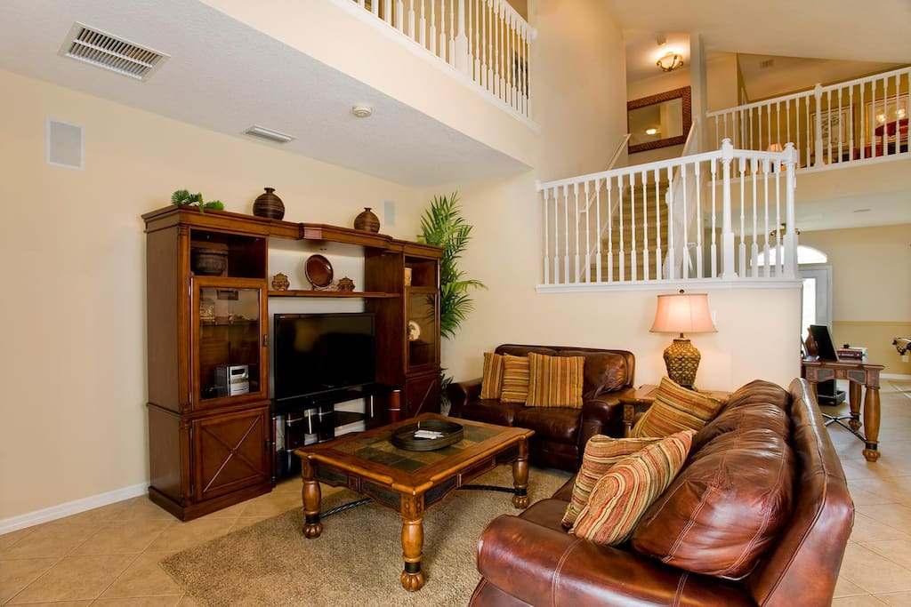 Spacious living area with 54-inch LCD TV, DVD/VCR combo & stereo system