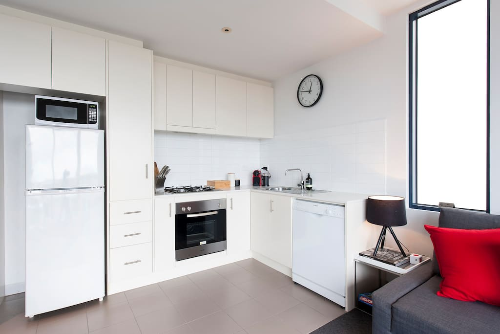 Kitchen with gas  stove, oven, microwave and dishwasher.