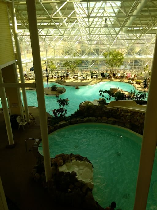 West building. indoor pool with waterslides and Roman spa.  Game  and workout areas, Oasis bar.