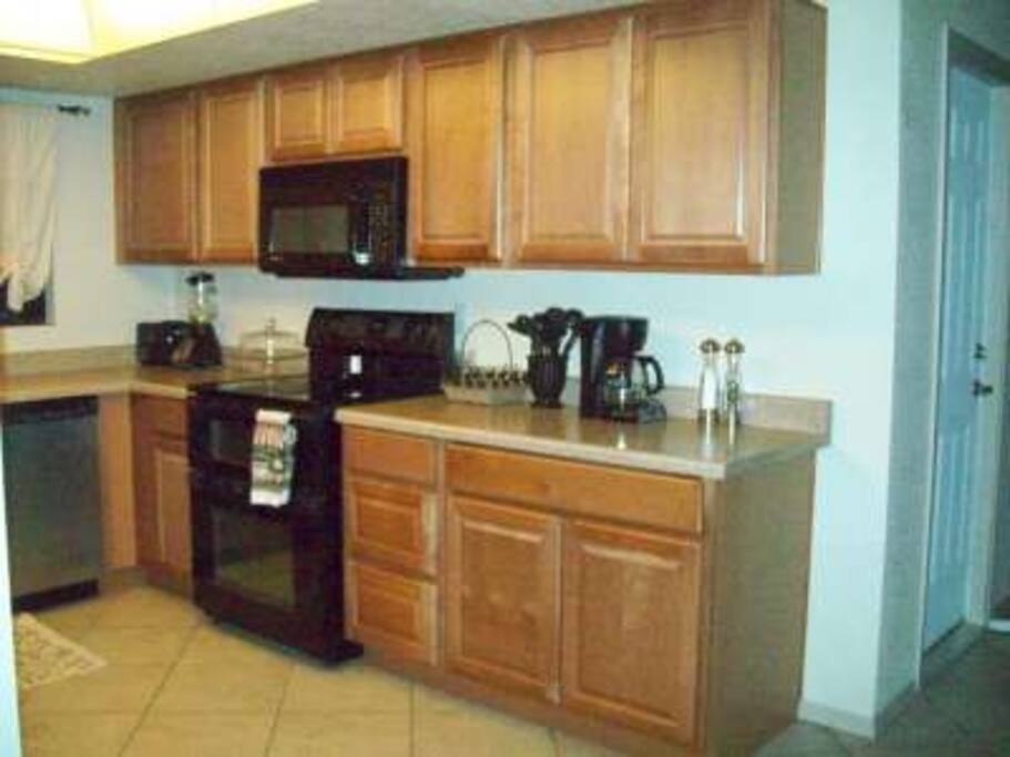 Open kitchen with all appliances and amenities
