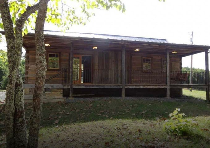 Ideal retreat in secluded one of a kind log cabin.