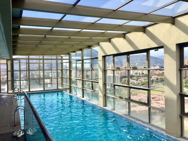 1 Bedroom Apt. in Santiago w/ rooftop views & pool